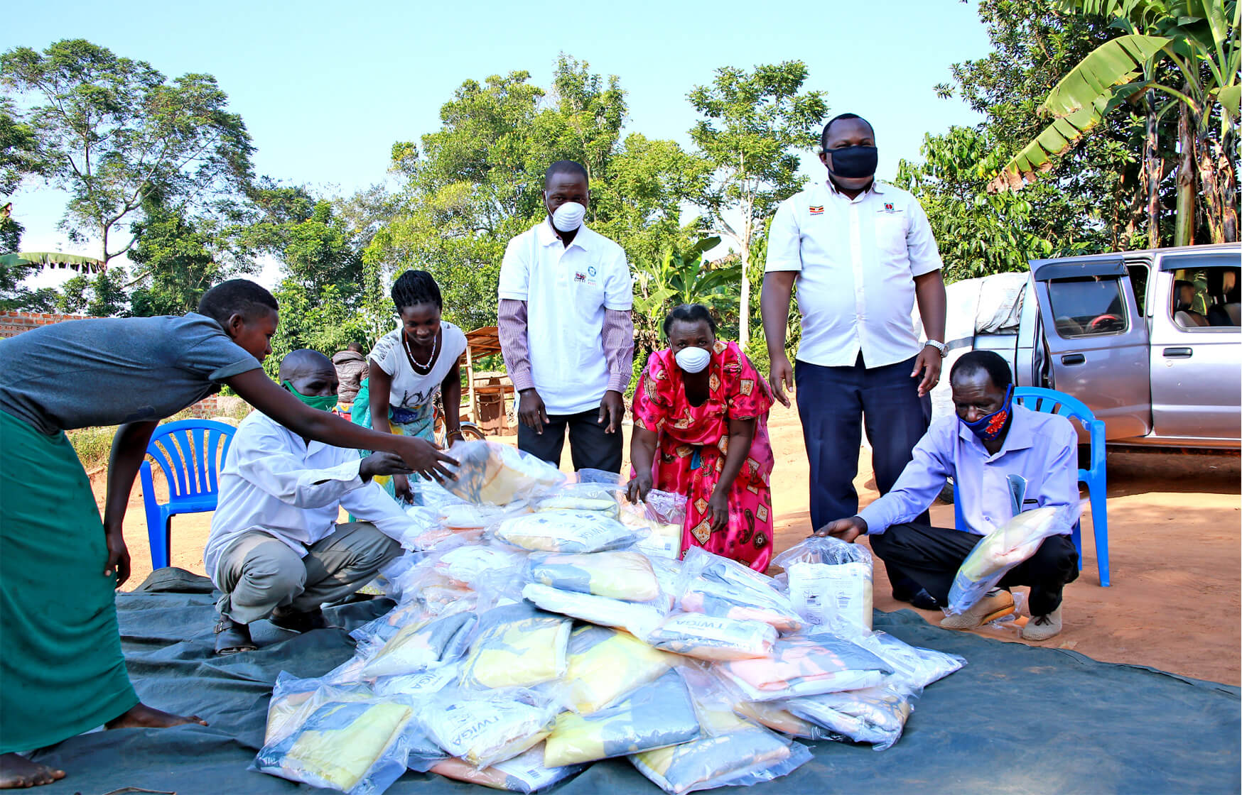 Collecting mosquito nets in Uganda
